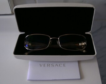 5195107f12f2 Versace Gianni glasses gilded leather case mount