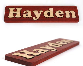 Personalized Solid Wood Name Puzzle made with Padauk and Maple. Your child's name as a puzzle
