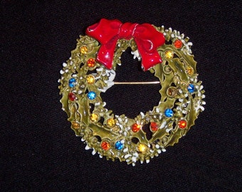 (12) Christmas BROOCH, signed ART, plant encircled, circa 1950's