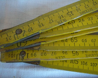 Vintage ruler folding yellow vintage double-meter, is retro, gadgets and tools