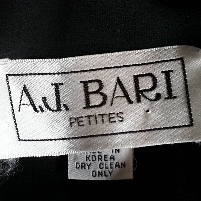 68df0068936e6 Black Polka Dotted Dress XS   belted full skirt vintage 90s