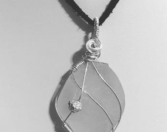 White sea glass pendant with silver wire wrap