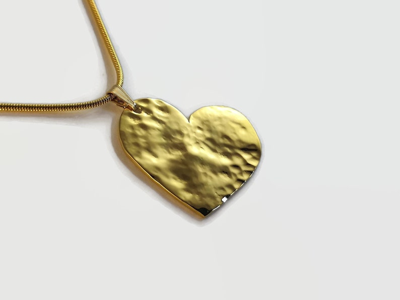 Gold Plated Heart Pendant Necklace Gold plated sterling silver with a hammered finish A beautiful romantic gift