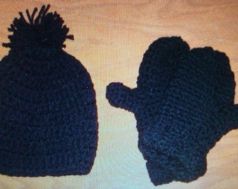 Crocheted black hat and mittens