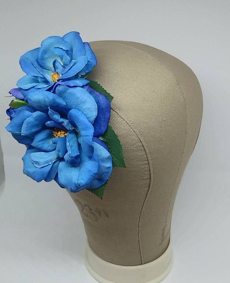 1940s Hairstyles- History of Women's Hairstyles Double blue roses hair flower with greenery $12.00 AT vintagedancer.com