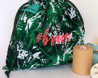 Paradise Green Hashtagbag, with multiple hot pink hashtag variations, grip bag, draw string bag