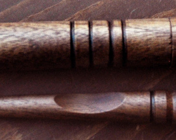 One of our walnut wood mini stitch lay helper tools with a walnut  wood needle case