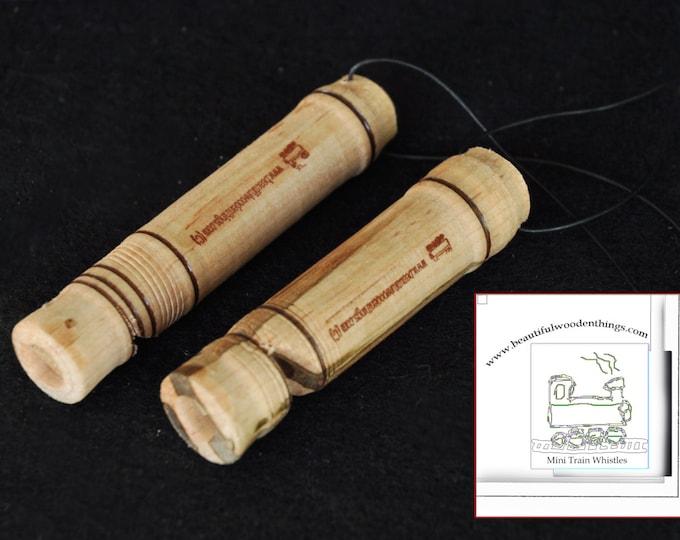 2-Mini wooden train whistles