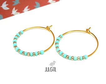 Rings gilded with gold end light turquoise and gold beads