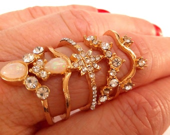 Set of 5 gold coordinated rings, rhinestones and nude pink size L 17/18.5mm