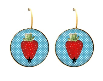 Strawberry cabochon curls on a sky-blue polka dot background