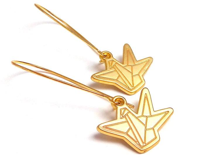Sleeping origami brass cranes