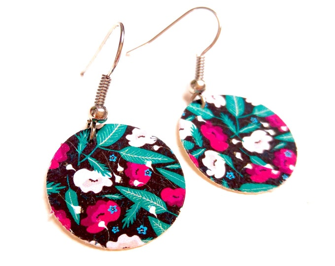 Liberty flower earrings on a brass cotton black background