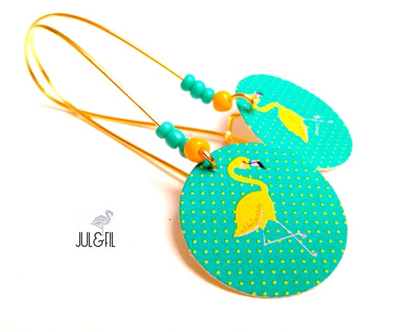 Yellow Flamingo earrings on Emerald background
