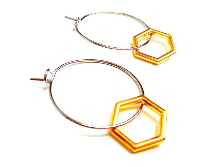 Minimalist brass rings hexagons