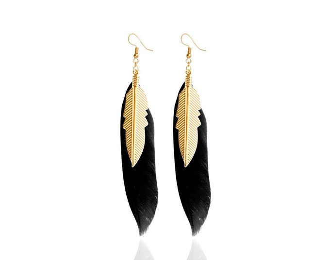 Black feather and brass rings
