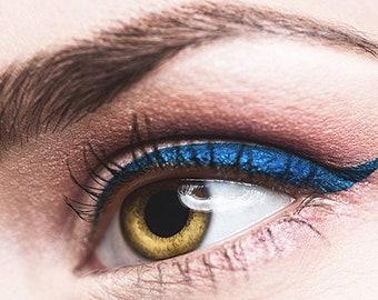 Long blue kohl pencil king eyes pencil-cut tip fades