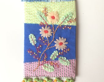 Covered embroidered textile for bujo or notebook