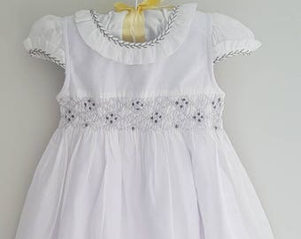 Beautiful white hand smocked dress - size 6-12 months, size 1 and size 2