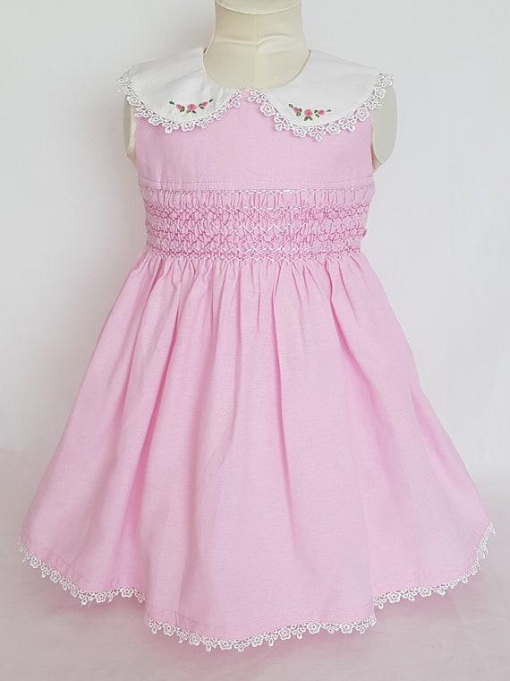 89d32b54355 Beautiful light pink hand smocked sleeveless dress with