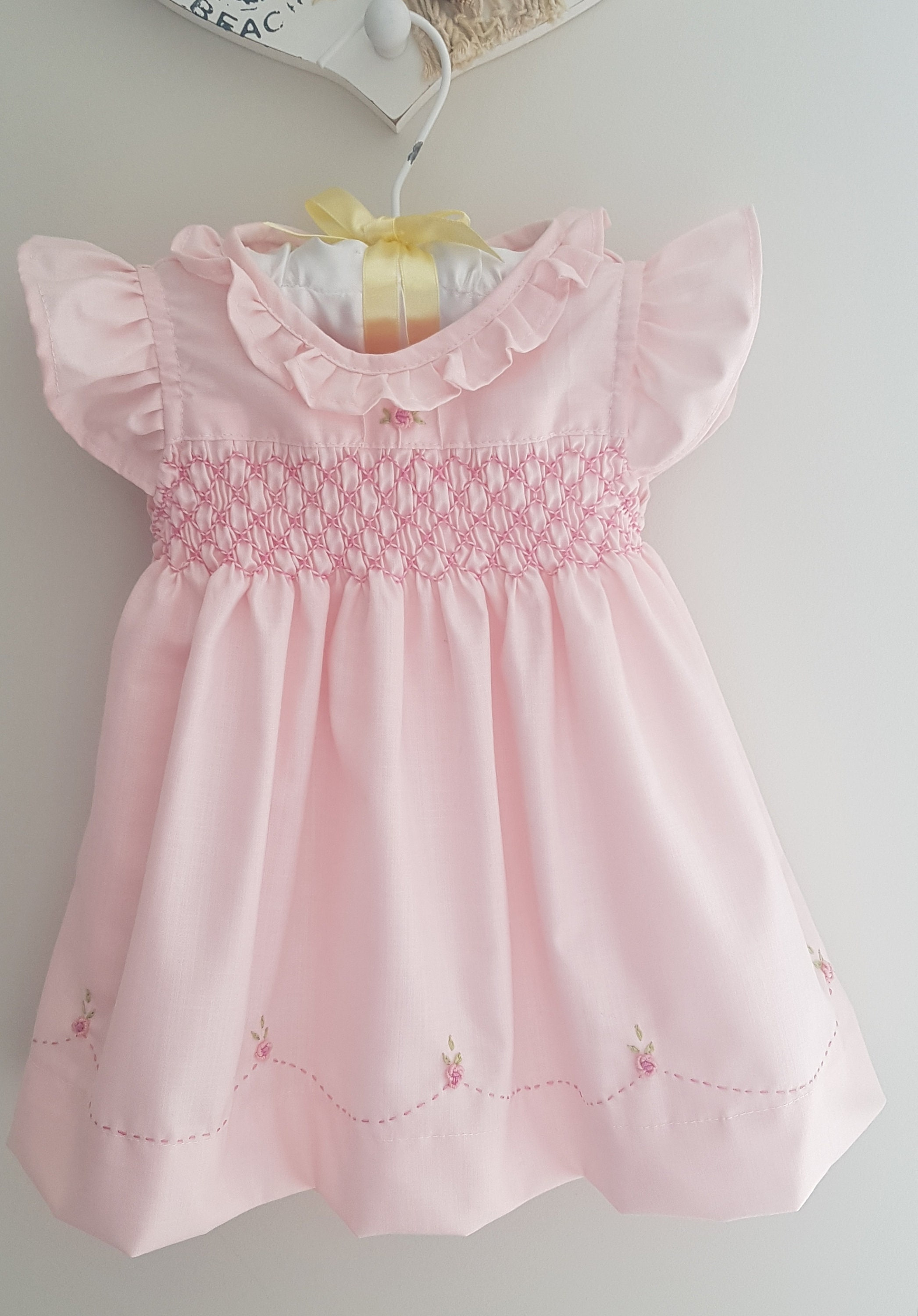 Stunning baby pink hand smocked baby dress with beautiful hand embroidery
