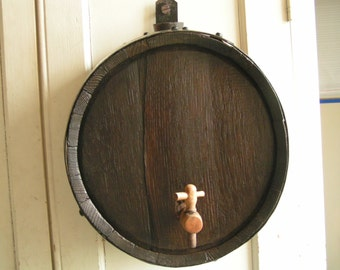 vinegar, already been used, made of stave oak, very pretty as decoration for a kitchen