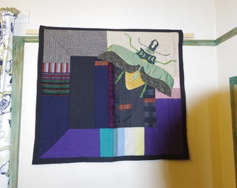 Applique, patched and hand embroidered wall hanging