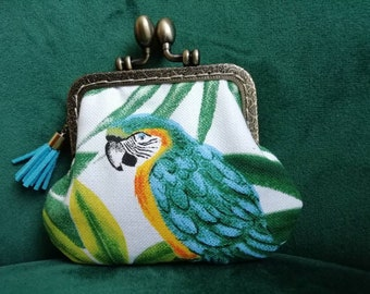 Parrot clasped wallet and tropical leaves