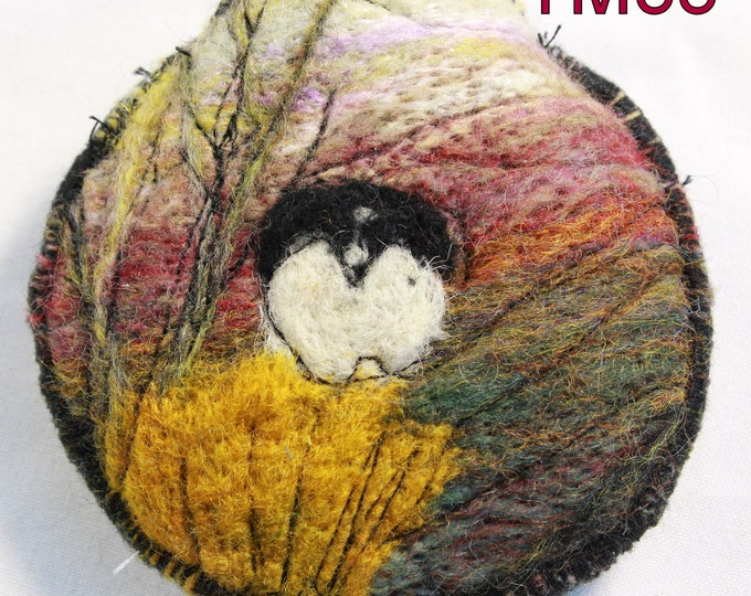 Needle-felted tape measure holder with tape measure