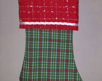 Red and green plaid Christmas stocking with white satin trim