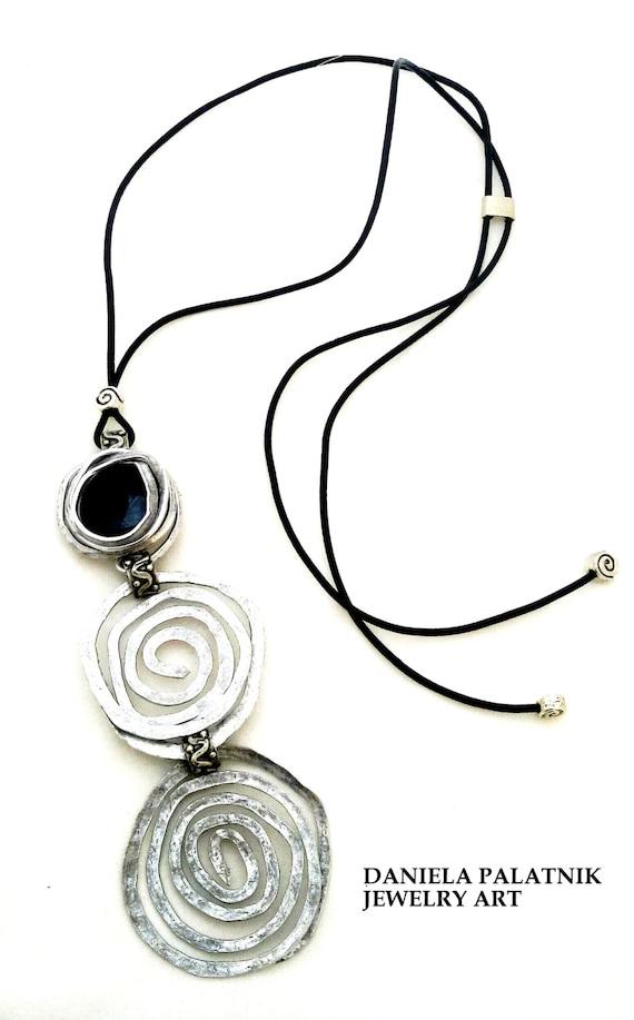 long pendant necklace black leather necklace spiral shape