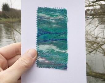 Blue handmade embroidery art card
