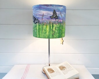 Butterfly and wild flowers embroidered round lampshade.