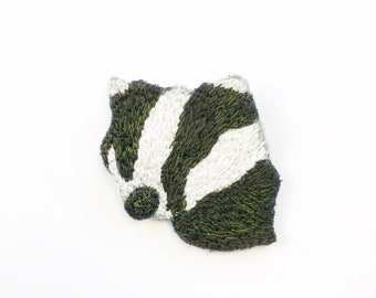 Black and white embroidered badger Brooch