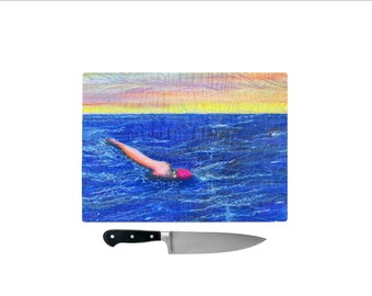 Sea swimmer at sunset' Tempered Glass Chopping Board
