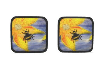 Hot dish holder pads.  Set of 2.  Bumble Bee embroidery art design print with black trim.