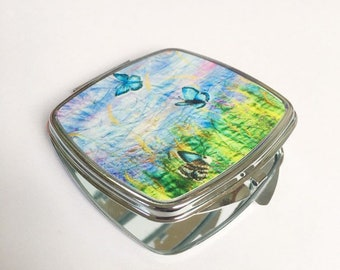 Compact hand mirror.  Butterflies and wildflowers embroidery art print  By Juliet Turnbull