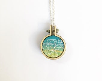 Necklace. Seaside theme embroidery hoop.