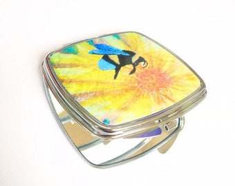 Compact hand mirror.  Honey Bee and flower.  By Juliet Turnbull