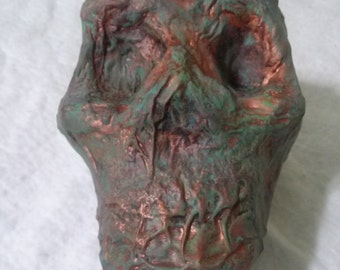 Handmade and hand painted aged copper skull.