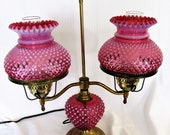 Fenton Cranberry Hobnail Trio Glass Student Lamp 23 quot and was made in the 1950 39 s. The Lamp has the original metal plated stand and globes.