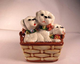 """Really Cute Mid Century Three Puppies in a Basket Pottery Bank made in Italy. The Hand Painted Bank has Applied Flowers and is 7"""" Tall."""