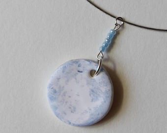 Spherical pendant necklace in fimo, decorated in cyanotype