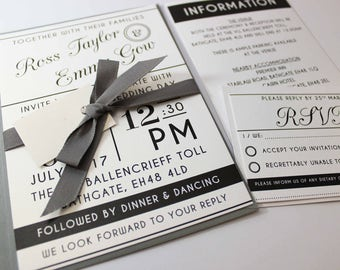 Black, white and grey wedding invitation package with grey envelopes ribbon and tag