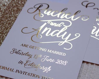 Luxury gold foil on silk white wedding save the date or evening cards with glitter lined white envelopes