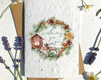 Biodegradable seed paper Christmas festive season greetings card traditional deer family house home joy