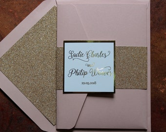 Gold glitter foil and blush pink pocketfold wedding invitations with glitter lined blush envelopes