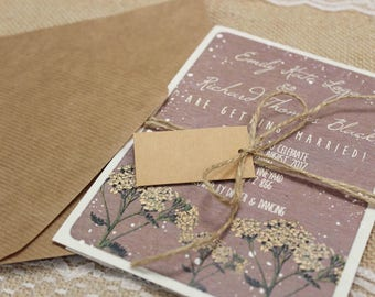 Rustic textured woodland flower spray wedding invitation package with envelopes