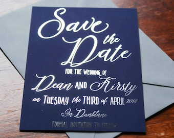 Silver foil and navy blue save the date cards with grey envelopes