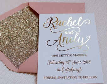 Luxury gold foil on silk white wedding save the date or evening cards with glitter lined blush pink envelopes